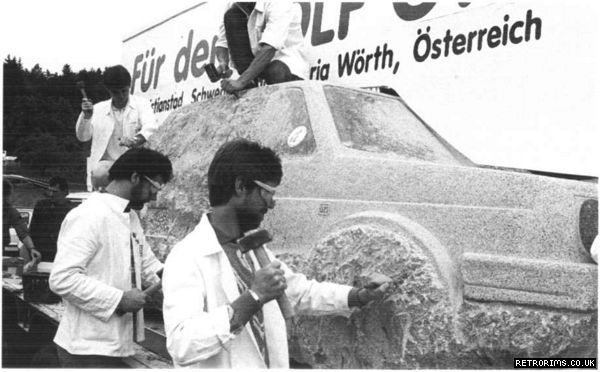 Craftsmen carve a VW Mk2 Golf from a block of stone at the 1989 GTI Treffen